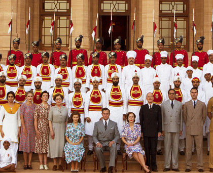 still from VICEROY'S HOUSE with cast including Lily Travers, Hugh Bonneville, Gillian Anderson, Manish Dayal and Huma Qureshi